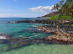 Secret Cove (also known as Pa'ako Beach) in South Maui. Just a few minutes drive south of popular McKenna Beach, it's a volcanic rock and tropical foliage oasis, with some of the prettiest water on the island.http://www.everintransit.com/maui-beaches-and-sunsets/