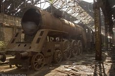 Rusting: A four-cylinder MAV 301 series which was in use 1911-1914 - one of only two left in the world - stands abandoned in the now derelict Istvantelek rail workshop in Budapest, Hungary