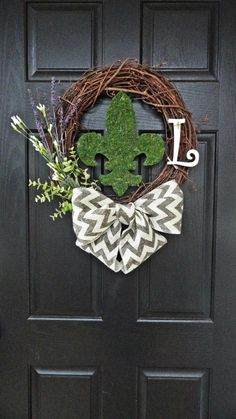 Rustic Elegance, Moss Covered Fleur De Lis and Chevron Burlap Bow, Spring and Summer Wreath for Front Door. $49.00, via Etsy.