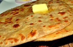 #AlooParatha Bread stuffed with potatoes, peas, slightly spiced and baked in tandoor