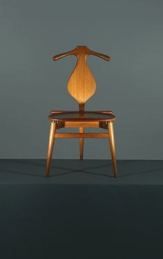 Combining the best traits of a bench and a butler, Hans Wegner's 1953 Valet chair is the one piece of midcentury-modern furniture that the fastidiously turned-out chap overlooks at his peril. Marrying formal elegance—these handsome curves have been handcrafted in PP Møbler's Danish workshop since it took over production in 1982—with a surprising functionalism, the Valet chair all but does away with the need for Jeeves. Initially a four-legged chair, Wegner decided to trim the final product…