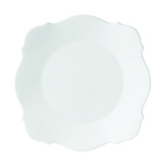 This Plate is elegantly rendered in fine, white bone china and features a new silhouette influenced by classic baroque arches and medallions | domino.com