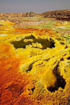 Dallol Volcano In The Danakil Desert:  The Danakil Desert lies in the Afar Triangle. It extends into the north-east of Ethiopia, the south of Eritrea and north-west of Djibouti.