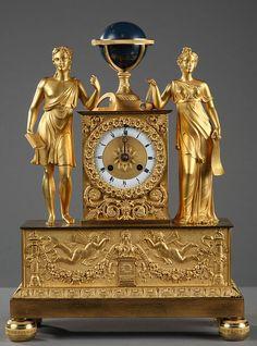 AN ORMOLU EMPIRE CLOCK 1810