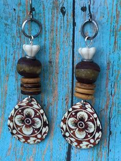 """Colorful and light Boho Chic earrings  embellished with African brown Kente Krobo Beads. Eclectic and Girly, with a boho artisan """"Found Treasure"""" feel. These super lightweight, easy to wear earrings a"""