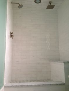 Instead of the regular 3×6, we used 3×12 marble tiles in an offset pattern. This elongated rectangle appears more modern thanthe classic subway, plus you have less grout joints to keep clean.