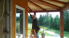 85 year old mother helping with the staining. Wrap around porch.