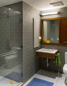 Grey subway tiles - I wonder what it would look like to have the grey glass on the top 1/3 and white subway tile with grey grout on the bottom 2/3? It would have to just the right border tile in between...