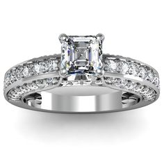 Asscher Cut Pave Set Diamond Engagement Ring - The polish is excellent on this 14K White Gold Asscher Cut Pave Set Diamond Engagement Ring featuring a very pristine .71 carat Asscher cut center stone on top of a slightly thick to thick metal girdle with 52 additional White Round Brilliant accent side stones. The Pave set engagement ring comes with an SI1 in clarity along with an F in color & the total gem weight is equal to 1.75 carats. The diamonds are 100% natural. #unusualengagementrings