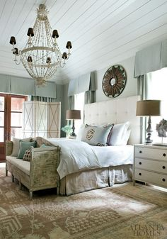Cozy bedroom with tufted headboard and waincot ceiling. Great color scheme- blues, taupes, grey and white.