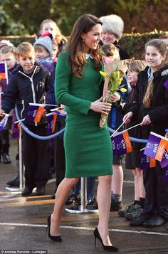 Kate opted for a green suit from Hobbs with a lace collar as she arrived at the children's centre in the Norfolk village of Quidenham to meet youngsters with life-threatening conditions