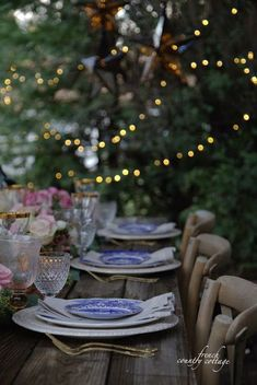 blue and white dishes on rustic table top with flowers