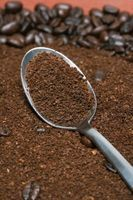 Instead of throwing away used coffee grounds, save them in a container to reuse in your garden. The dried grounds provide organic soil nutri...