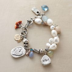 """PERSONALIZED LOCKET BRACELET--Our exclusive edition from Jes MaHarry is bold and bountiful, with an """"open your heart and free your mind"""" heart charm and a personalized locket (4 letters max). Handmade in USA with blue chalcedony, London blue topaz, prehnite and rare, antique whiteheart beads; sterling silver and 14kt rose and yellow gold charms. Hook clasp. Approx. 7-1/2""""L."""