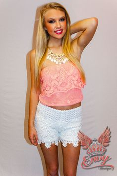 Southern Lace Crop Top in Pink - Sweet and girly in a lovely neon pink crotchet lace cropped tube top. An exposed and sheer floral lace ruffle wraps around the top of the bodice giving a cutesy edge. Made unique by the flirty cropped length, this piece is soft and feminine for casual spring and summer days that need a little feminine boost. Great paired with high waist shorts and cowgirl boots for a Southern girl's lacey look!  - available online at http://www.envyboutique.