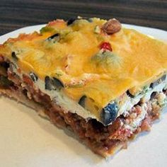 Easy Mexican Casserole - This is an easy and very tasty dish. I often substitute ground turkey and low fat dairy products and it is still delicious! Serve with chips, salsa and green salad.