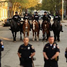 470733590-baltimore-police-mounted-officers-stand-at-the-ready_3