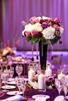 Purple #uplighting accentuates this beautiful #purple #centerpiece display