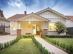 Californian bungalow facade ideas: red tiles, weatherboard and brick. Nice paint scheme.