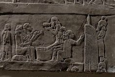 Warriors taking their meal protected by a guard with shield. Siege of the Elamite city of Hamanu. Stone bas-relief (7th BCE) from the palace of Ashurbanipal in Niniveh,   Mesopotamia (Iraq).  Louvre Museum