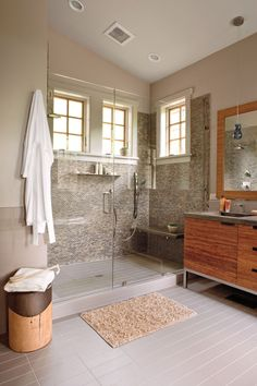 For a contemporary look, use furnishings and materials with crisp, straight lines. The clean rectangular shape of this vanity is reflected in the tile.