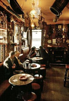 """'The main saloon bar of the """"Olde Ship"""" has tremendous character lit by stained glass windows and in winter by the welcoming glow of an open fire. Adjoining the main bar - is another - snug, low beamed,""""The Cabin"""". The pub is a veritable sea museum -The scrubbed wooden floor is constructed from pine ships decking, while the walls are festooned with a wide variety of nautical artifacts, model fishing boats and a replica of Seahouses' lifeboat, The 'Grace Darling'. Figure heads, diving…"""