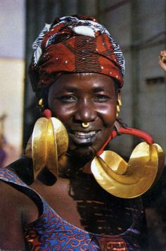 Africa | Fulani woman wearing traditional gold earrings.  Haute-Volta (Burkina Faso) || Scanned postcard; publisher DiaVolta.  No 76/968.