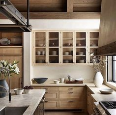 Perfect cabinets with stained cement counters and light tumbled stone tile for flooring.