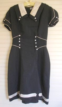 Navy blue bathing suit from Yale Knitting Mills, American (New York), c. 1917. At this time, women's bathing suits where still two-piece affairs, consisting of a dress and bloomers, to which would be added stockings, shoes, and a cap.