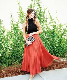Pair a pleated maxi with a cropped black top for a dressy night