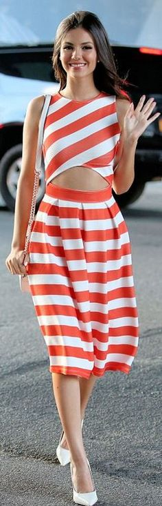Who made Victoria Justice's white stripe cropped top, white pumps, handbag, and pleated orange skirt?
