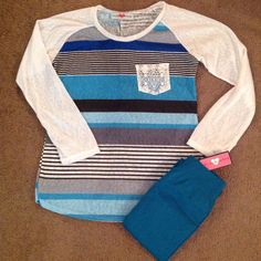 Lace Pocket and Stripes Top in blue -- Lace & stripes in one comfy top -- does it get any better?! We vote no! Fashion. www.psiloveyoumoreboutique.com