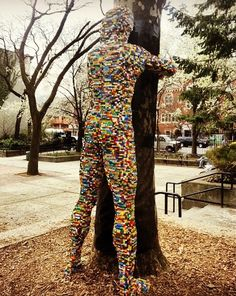 Lego tree hugger. NYC street art