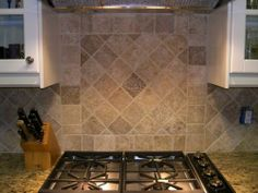 "Finished Backsplash I like having a border on the top as well as on the bottom of diagonal 4"" squares."