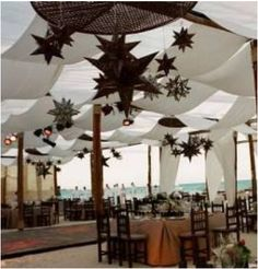 XTR-201 Rustic wooden pole structure with white drape (30X 30 feet) without stars.