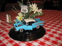 car box centerpiece www.tablescapesbydesign.com https://www.facebook.com/pages/Tablescapes-By-Design/129811416695