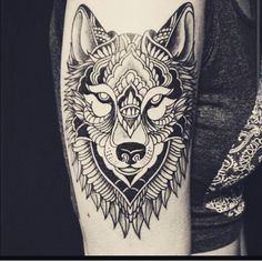 Black and gray wolf tattoo