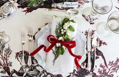 Dining table:  Astier de Villatte dishes, with vintage napkin and white snow berries tied with a pale pink velvet ribbon. Use Grandma's First Love silverware