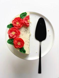 lemon poppyseed cake with raspberry buttercream