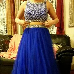 SALE- Beautiful blue evening gown Beaded crop top and beaded skirt. 2015 design from Anny Lee. My sister wore it for prom and paid almost $500. it is in great condition and was only worn once. Reasonable offers considered :) Anny Lee Dresses Prom