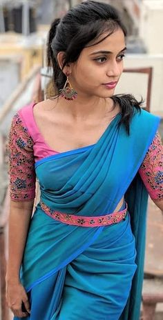 She is an Indian Model . Wedding Saree Blouse Designs, Half Saree Designs, Saree Blouse Neck Designs, Fancy Blouse Designs, Saree Trends, Designer Blouse Patterns, Saree Models, Stylish Sarees, Saree Styles