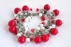 Red, white and silver beaded charm bracelet by TheBeadedCatsEye