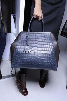 Gucci, Gucci, Louie, Louie, Fendi, Fendi, Prada.. This Fendi bag is def not for basic b's! #chicevolution #chic #Fendi