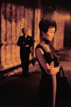 """""""It is a restless moment. She has kept her head lowered... to give him a chance to come closer. But he could not, for lack of courage. She turns and walks away.""""   ~ In The Mood For Love (2000)"""