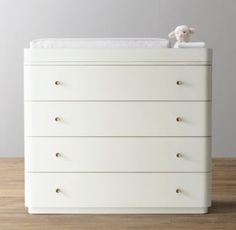 RH Baby & Child's Seraphina Dresser & Topper Set:Streamlined Seraphina features perfectly rounded corners that evoke the glamour of the Art Deco era. Brass-finished hardware offers an elegant accent in keeping with its polished appeal.