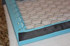 Display and settle on a picture frame with chicken wire.