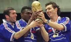 France , World Champion in 1998 , Zinedine Zidane , Marcel Dessaily and Laurent Blanc hold trophy