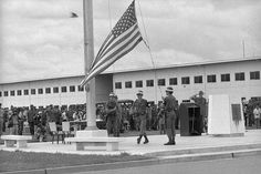 The flag comes down at the U.S. Army base at Long Binh, 12 miles Northeast of Saigon, as the base is turned over to the South Vietnamese Army, Nov. 11, 1972. It was at one time the largest American base in Vietnam with a peak of 60,000 personnel in 1969. (AP Photo)