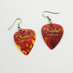 Check out this item in my Etsy shop https://www.etsy.com/listing/209315732/guitar-pick-earrings