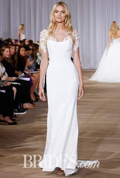 "Brides.com: . ""N9 Twilight"" silk crepe sheath gown with collaged lace illusion sleeve and sweep train with buttons extending to tip of train, Ines Di Santo"